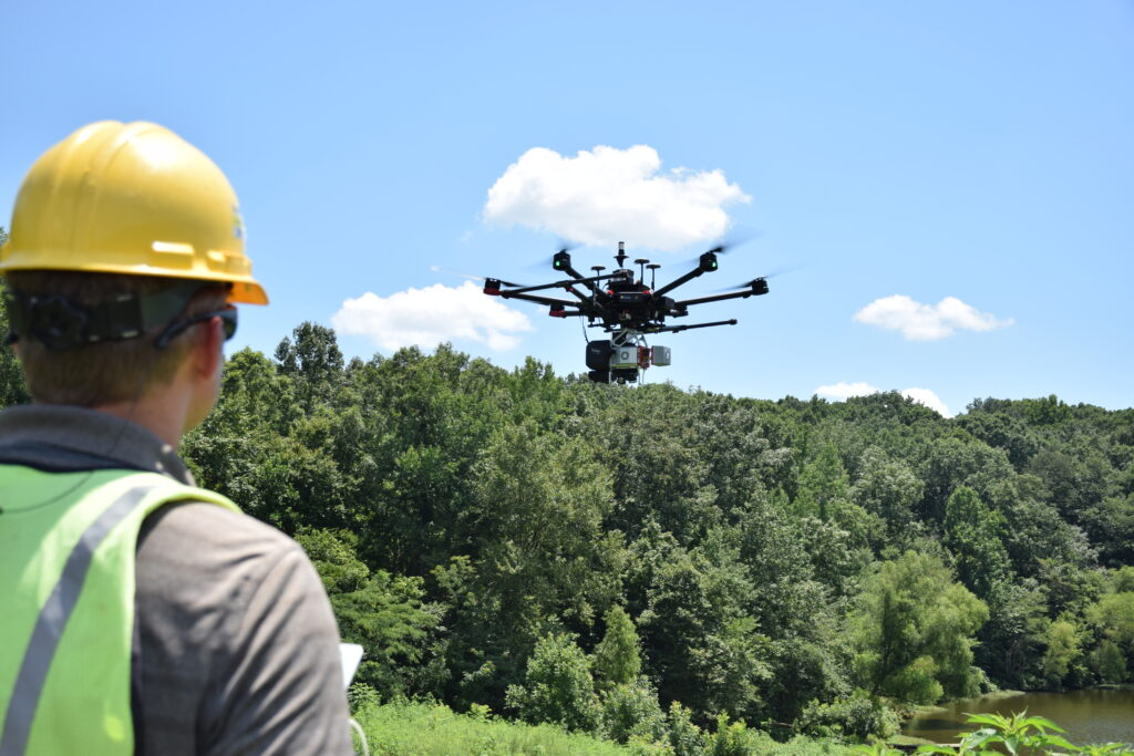 Surveyor out in field with True View 620 on DJI M600